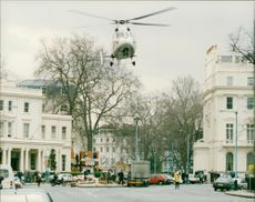 Air ambulance taking off from belgrave square.