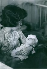 Woman holding a wounded child.