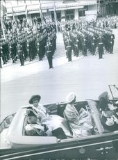 Battalion of officers are paying respect to the Royalties. 1961