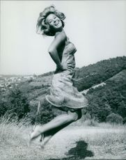 A woman jumping merrily.
