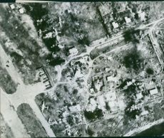 Aerial view of a city during wartime.