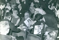 François Charles Mauriac giving autograph to people.