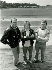 "Tord Bertilsson, Flemming Pehrson and Bosse Andersson with the battlefield ""Strandvallen"" in the background"