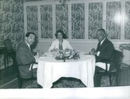Pierre Mendes France eating together with two other people.
