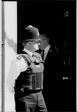 Armed police with bulletproof wars are guarded at Downing Street
