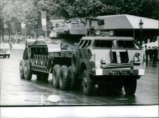 French military war tank in street during an event. Photo taken on July 17, 1962.