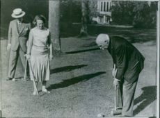 Philippe Petain playing golf with hes wife  Eugenie Hardon. 1962