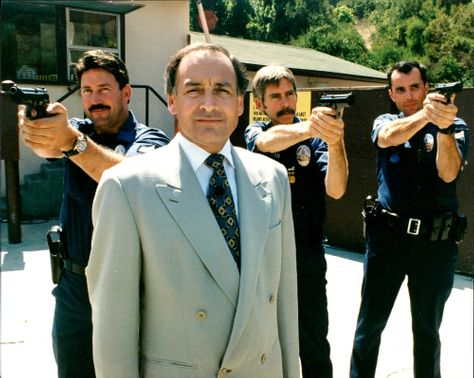 Alastair Stewart with members of the los aneles police force.