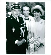 Herbert Lom as Commissioner Charles Dreyfus, Roberto Benigni as Gendarme Jacques Gambrelli and Claudia Cardinale as Maria, striking a pose, from the film Son of the Pink Panther, 1993.