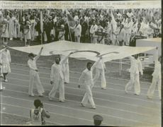 The Olymic tabloid is brought into the arena - the Olympic Games in Montreal in 1976
