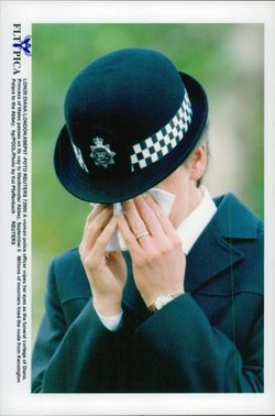 Female police wipe the tears at Princess Diana's funeral