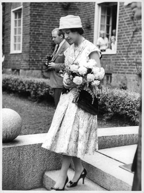 Princess Margaretha carrying flowers bouquet.