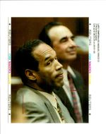 OJ Simpson sits in court February 12 with attorney Robert Shapiro.