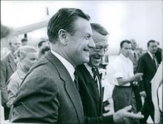 Nelson Rockefeller having a conversation with a friend.