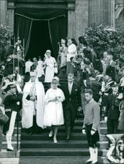 Albert II of Belgium and Queen Paola of Belgium coming out of building and receiving honour of guard.