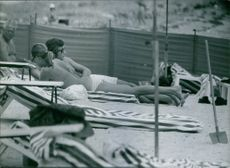 Princess Birgitta of Sweden and Hohenzollern pictured sunbathing with unknown man.