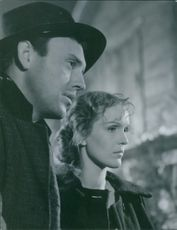 A photo of Eva Elisabet Dahlbeck and Ragnar Falck from the set  of 1949 Swedish drama film directed by Alf Sjöberg.