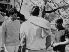 "Edward Moore ""Ted"" Kennedy talking to a man."