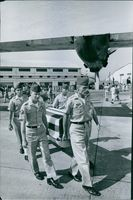 A vintage photo of US soldiers carrying the coffin of soldiers who fought for countries peace and order during war in Vietnam.