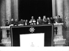 Pope Paul VI standing from the central balcony of St. Peter's Basilica at the Vatican.