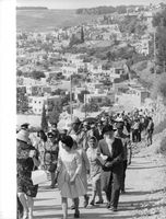 People from Israel walking, going uphill.