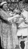Lew Hoad receives the golden trophy of the Duchess of Kent after his win in Wimbledon in 1956