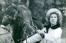 Duchess of Alba with his son on horseback riding.