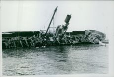 View of a sinking ship in the water.  Koit  1931