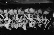 Picture of Russian dancers in Disco club in Paris Performers are dancing on the center stage with their head dress on