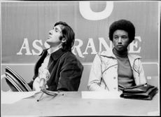 Romanian tennis player Ilie Nastase and American tennis player Arthur Ashe at a press conference