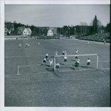 Footballers playing football in the ground.