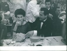 Silvana Mangano enjoying meal.