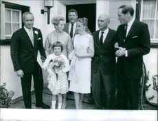 Peter Viertel and Deborah Kerr with few other people.  Year: 1960.