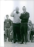 Arnold Palmer smoking a cigarette beside Jack Nicklaus.