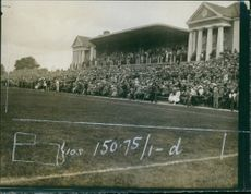 Crowd gathered in the playground to watch the match. 1918