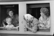 Mother and son seeing in the window while the two women looking at them