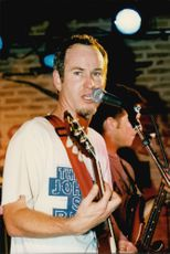 John McEnroe performs with his rock band Johnny Smyth Band at Chesterfield Cafe