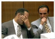A weary O.J. Simpson rubs his face at the end of a long day in court.