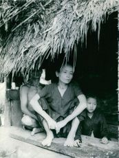 Vietnamese locals standing by inside their house.
