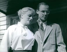 Nelson and Mary Rockefeller standing and looking at something.