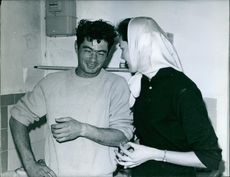 Judy Russel talking to a man and smiling.