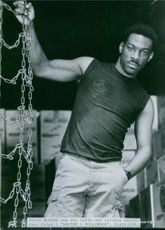 Eddie Murphy as the tough and inquisitive cop Axel Foley in the film Beverly Hills Cop, 1984.