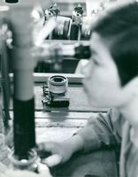 Child having an experiment inside the laboratory in Tokyo, Japan.
