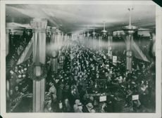 Crowd gathered in the hall. A department store is a retail large retail area of at least 1 500 m² and with a wide range of goods . The business idea is that with sales divided between different departments to offer the consumer to shop for many items of v