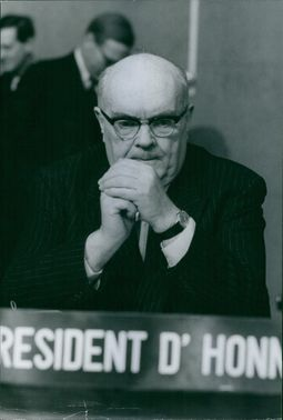 Paul Henri Spaak hands together and contemplating.