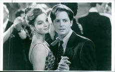 """A scene from the film """"For Love or Money"""", with Michael J. Fox as Doug Ireland and Gabrielle Anwar as Andy Hart, 1993."""