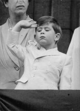 Charles, little Prince of Wales, saluting.