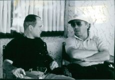 Director Christopher Cain and actor Joe Pesci on the set of the film Gone Fishin, 1997.