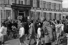 Queen Juliana waving at the crowd.