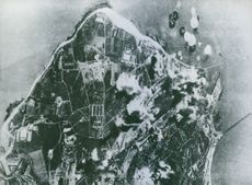 Bombs from Liberator bombers of the Eight US Army Air Force burst in the harbor and dock area of the German U-boat base at La Pallice, France.
